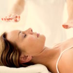 Reiki healing session with massage therapist