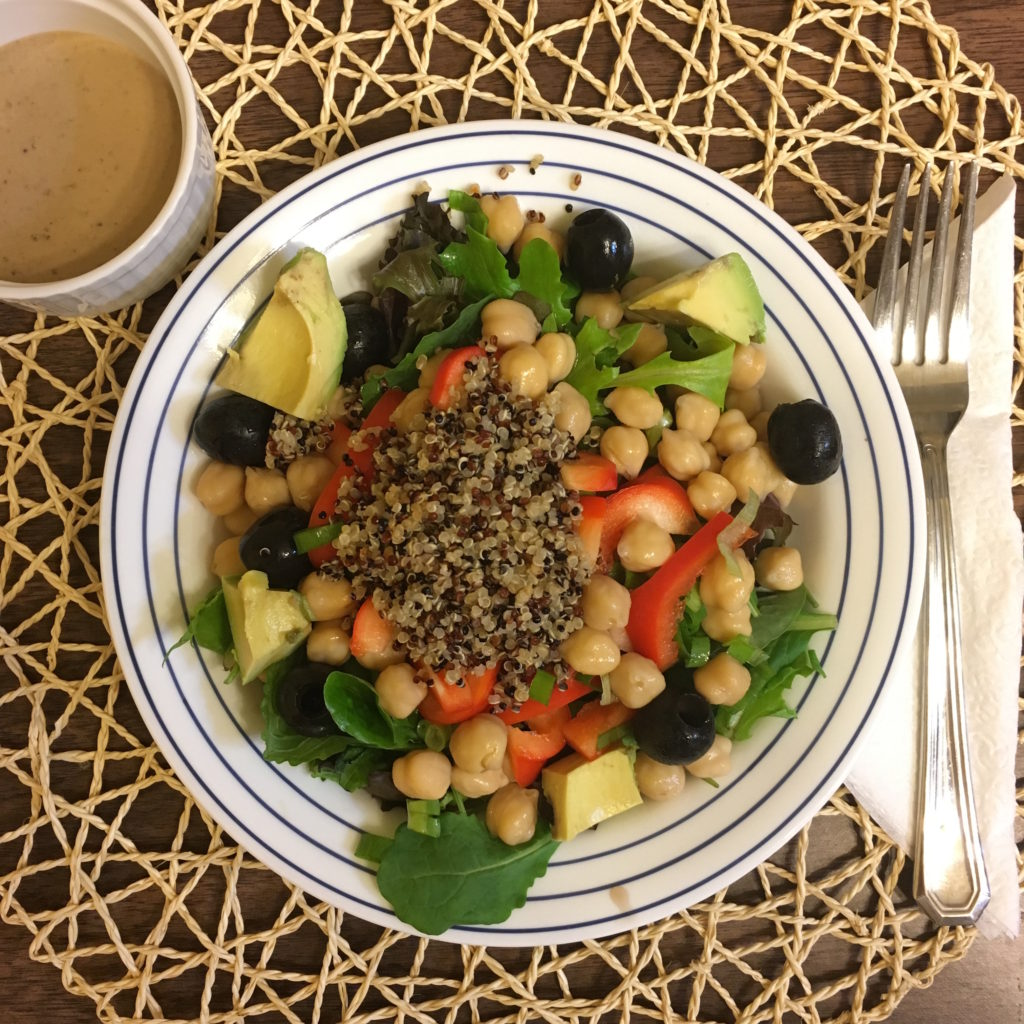 Chickpea salad with spring salad and black olives