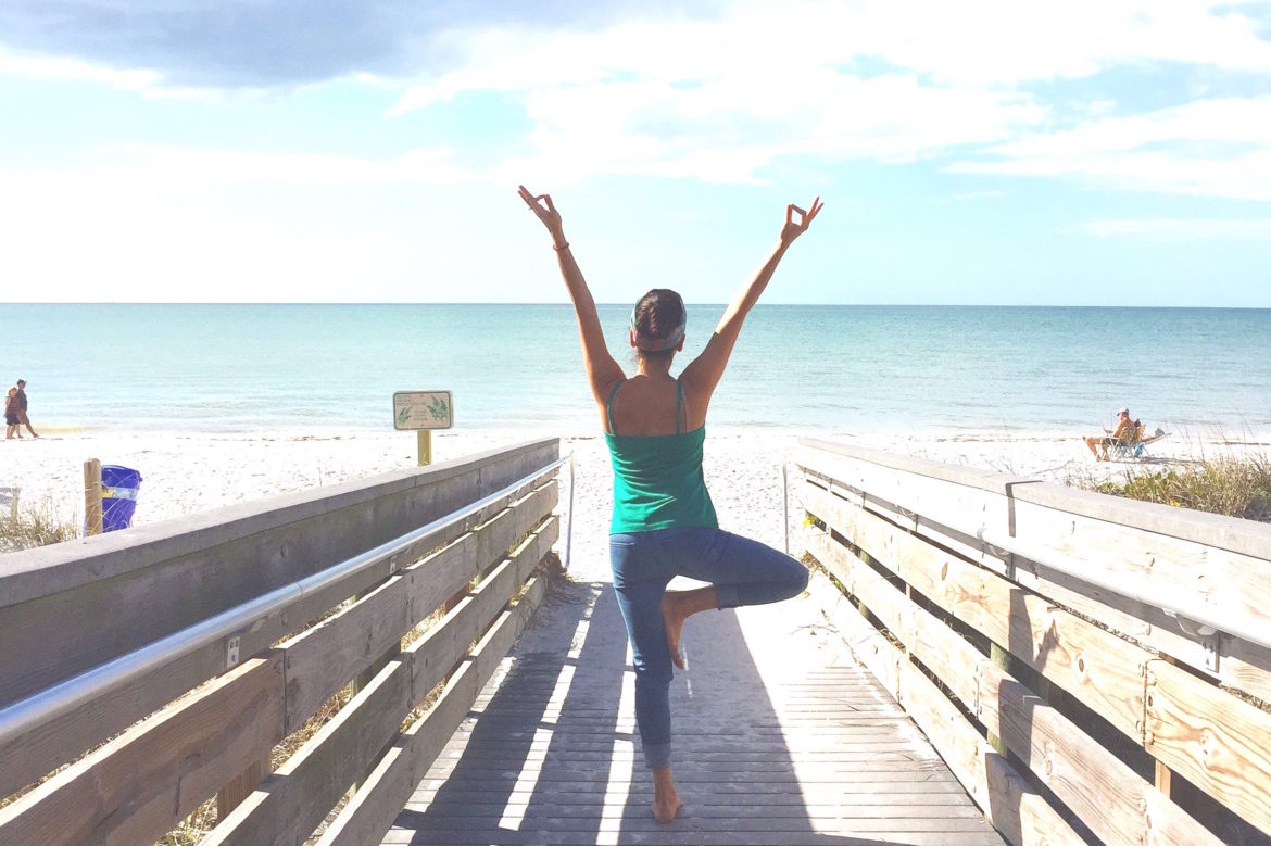 Yoga at the beach makes me happy