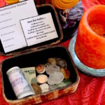 manifestation wishlist, crystals and coins for reiki prosperity box